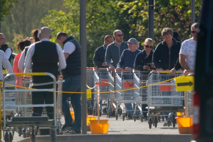 People line up outside busy Ashfield store today