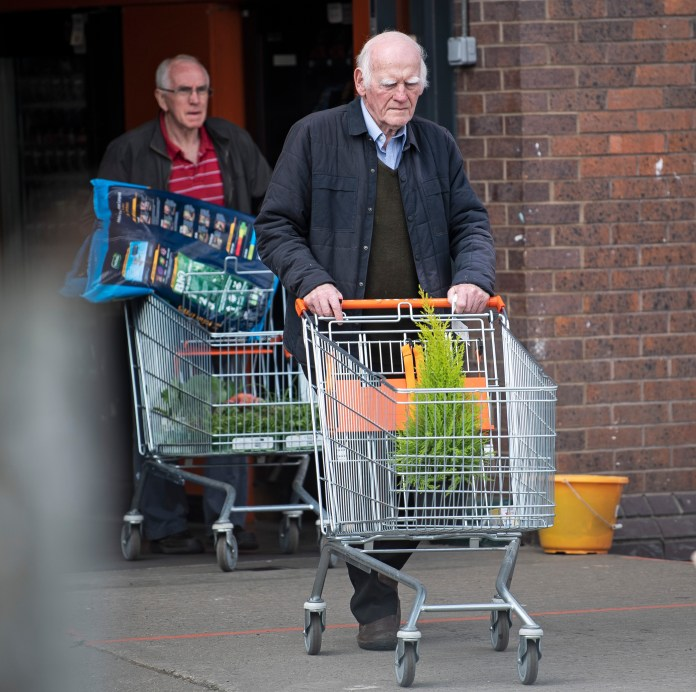 A customer leaving B&Q in Cricklewood, north London
