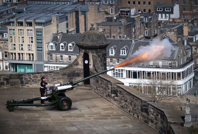 Sergeant David Beveridge fires a gun salute from the ramparts of Edinburgh Castle to mark the start of the two-minute silence