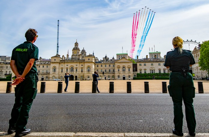 Paramedics watch red arrows over London