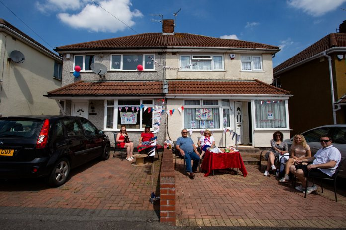 Families settle outside their home in Bristol to celebrate Victory Day