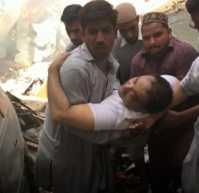 The moment banker Zafar Masood is pulled from the wreckage