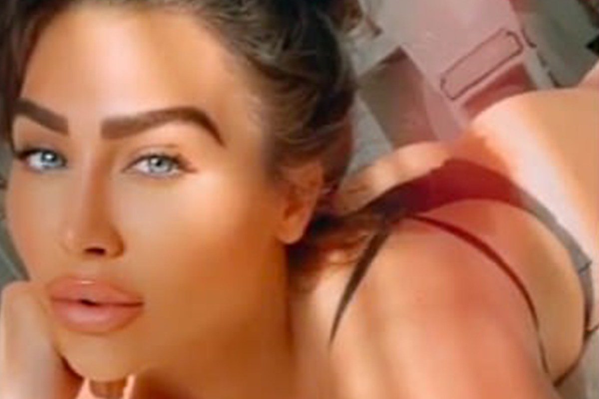 Lauren Goodger stuns fans as she goes topless in cheeky G-string video