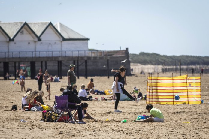 Sun lovers enjoy the hot weather at Super Weston Mare today