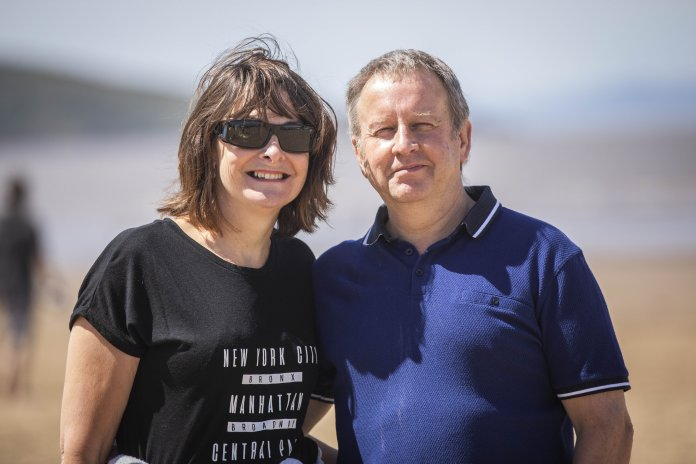 Stewart and Dawn Griffiths on the beach at Weston super-Mare