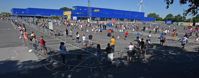 Buyers face three-hour queues to enter stores