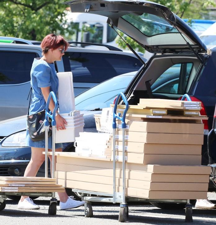A woman loads her car trunk