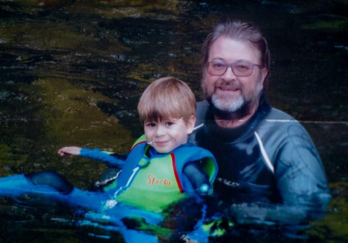 Derek and Billy swim together
