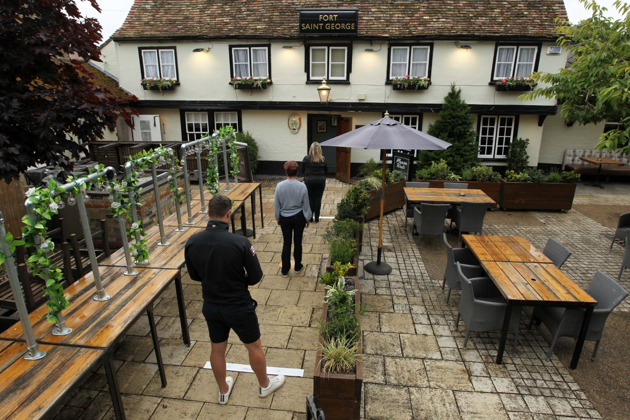 Punters will have to social distance before being allowed in, as shown at a Greene King pub