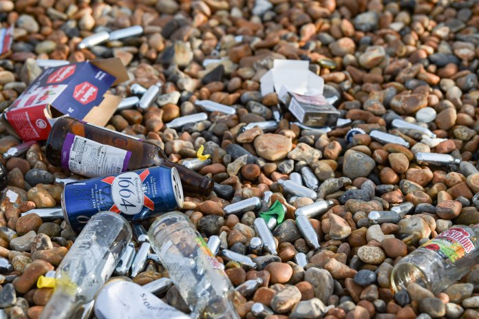 Packets of cigarettes, cans and bottles were scattered on Brighton Beach