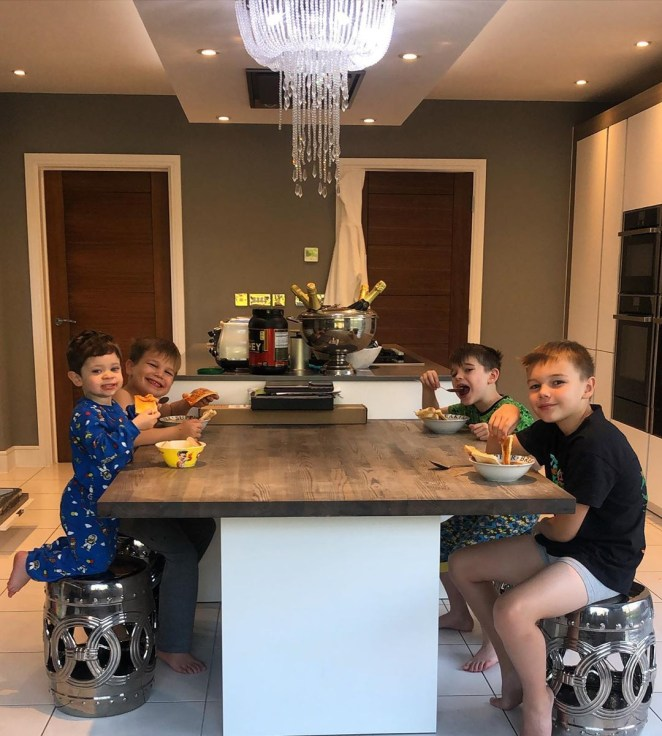 The kitchen features an island that the boys can eat breakfast together on and enjoy each other's company