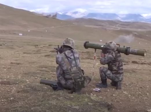 Chinese soldiers use bazooka during exercise