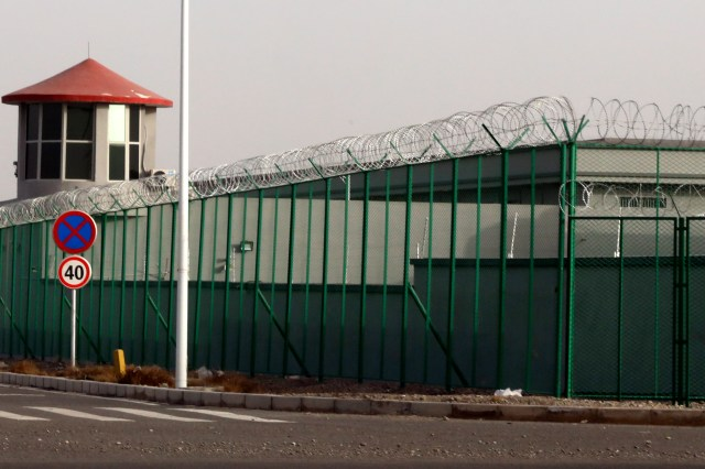 A guard tower and barbed wire fences surround one of the so-called 'centres'