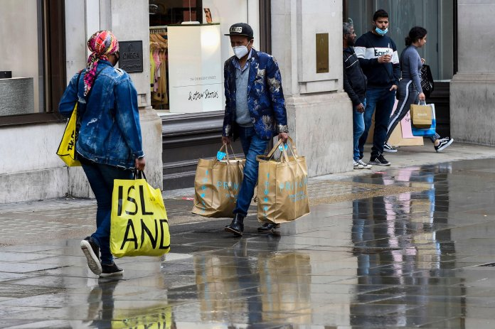 Discouraged Buyers Walk in the Rain on Regent Street