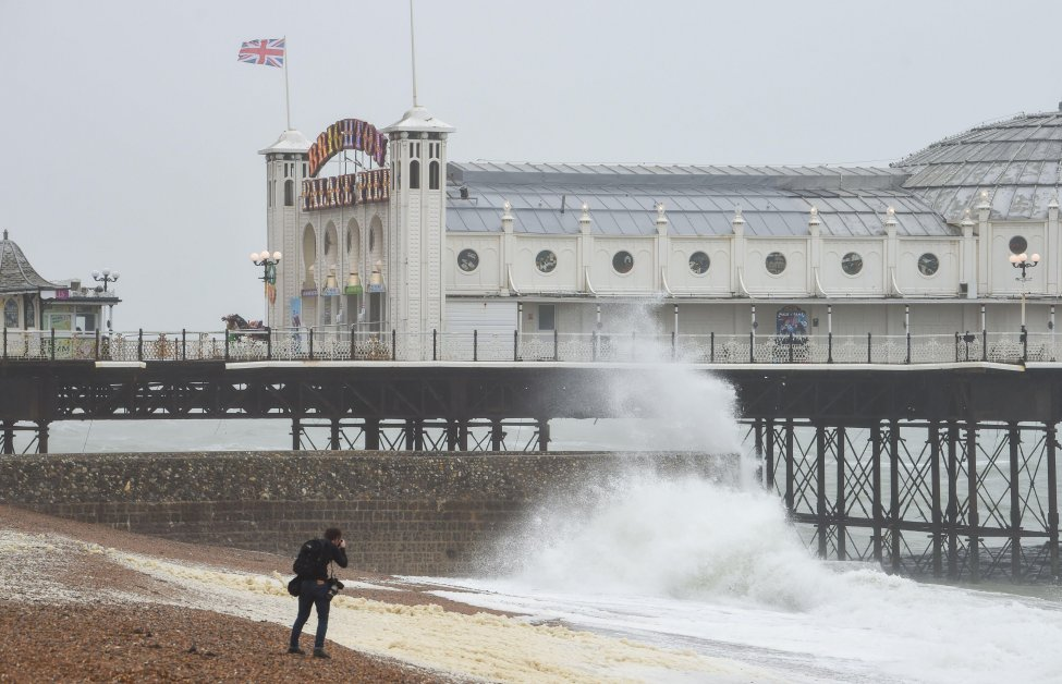 Waves crash near Brighton Palace Pier after a rainy and windy Saturday on the south coast