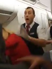 Cabin crew then move in to help the woman