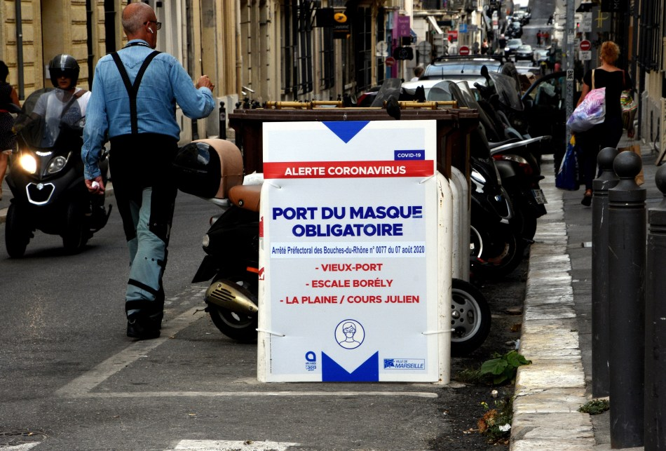 A sign urging locals to wear a mask at the Old Port area in Marseille