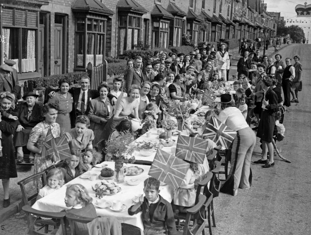 Families celebrate VJ Day in Heeley Road, Selly Oak with a street party on August 15, 1945