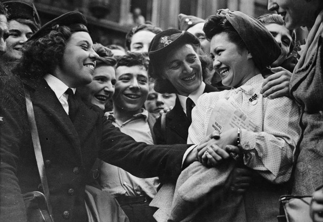 Mrs Lotus Lee-Chang (Lulu to her friends) whose husband was an Army lieutenant fighting in China, surrounded by well-wishers