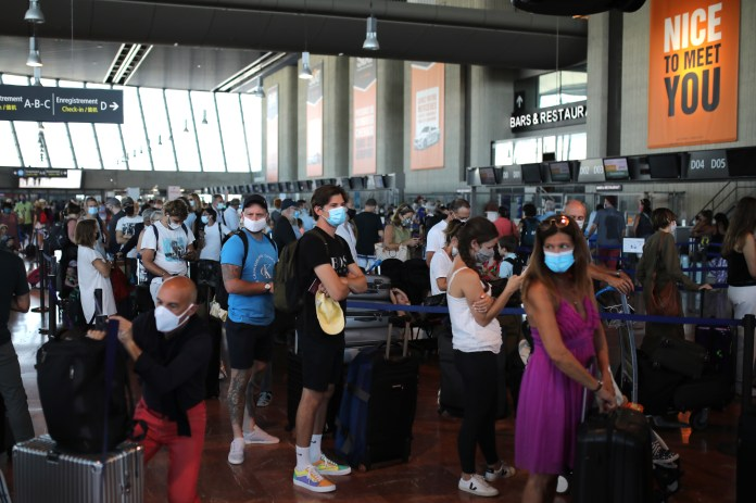 Large queues formed for check-in for a British Airways flight to Heathrow Airport from Nice