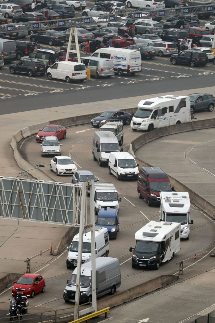 Vehicles were driven from a ferry in Dover after arriving from France on Friday - narrowly avoiding quarantine restrictions