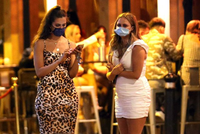 Revellers were still being COVID-19 safe, wearing masks with their party dresses