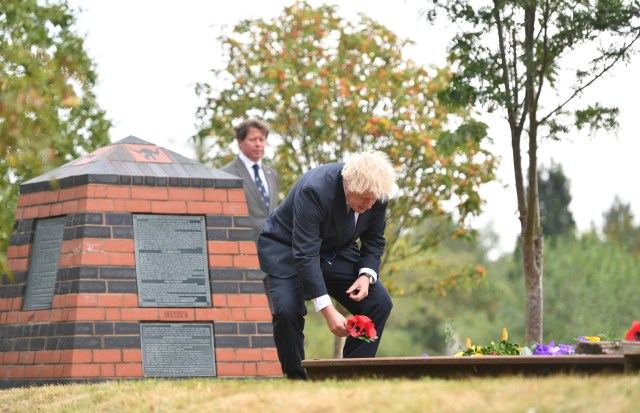 PM Minister Boris Johnson lays a wreath during a national service of remembrance