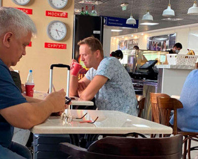 Alexei Navalny was snapped drinking from a cup at a cafe at Tomsk airport in Russia before catching his flight, during which he began experiencing horrific pain