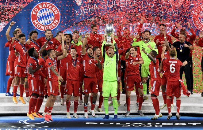 Bayern Munich lifted the Uefa Super Cup to complete a quadruple with a 2-1 win over Sevilla