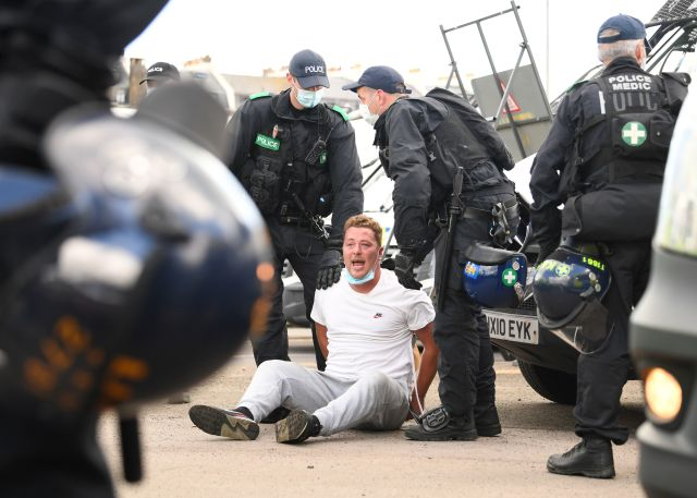 One man sat on the floor as police tried to get him up