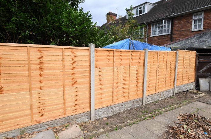 They had a new fence installed between the two gardens after the destruction of a huge hedge