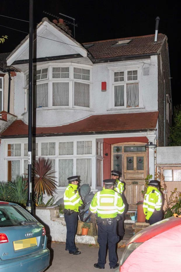 Cops outside a house being searched in Norbury, South London