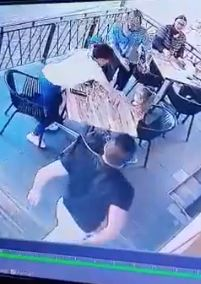 The man lunges for the child as one of the women dives to protect her