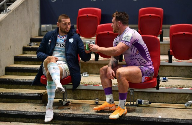 Scottish pair Finn Russell and Stuart Hogg share a beer after the game
