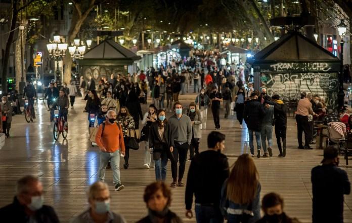 People wearing face masks walking on Las Ramblas in Barcelona yesterday