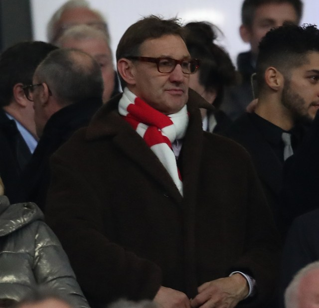 Tony Adams believes Arsenal should stop playing three at the back