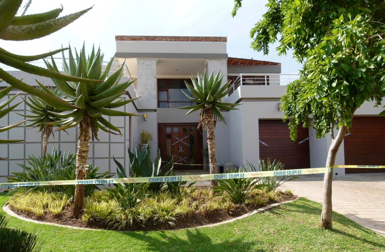 Reeva was shotfour timesthrough the closed door of the toilet in their Pretoria home