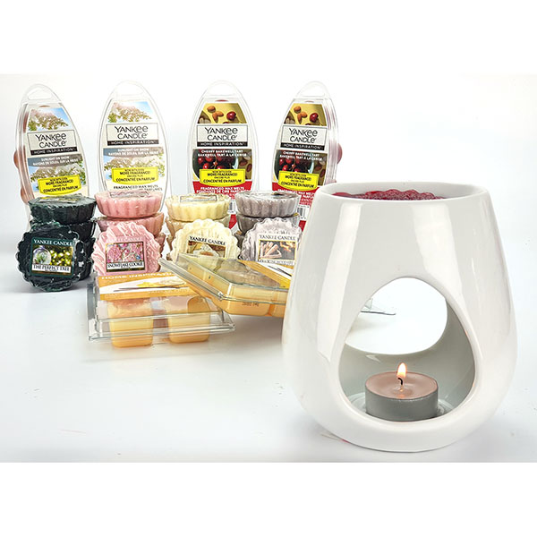 Wax melt burners can be bought cheaply and just need a tea light below and wax melt on top for a cheap home fragrance