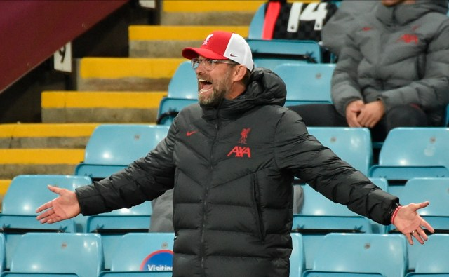 Klopp could only watch as his champions shipped seven at Villa