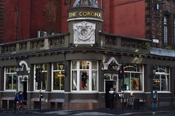 A man walks into the Corona pub in south Glasgow today on the eve of a two week pub closure