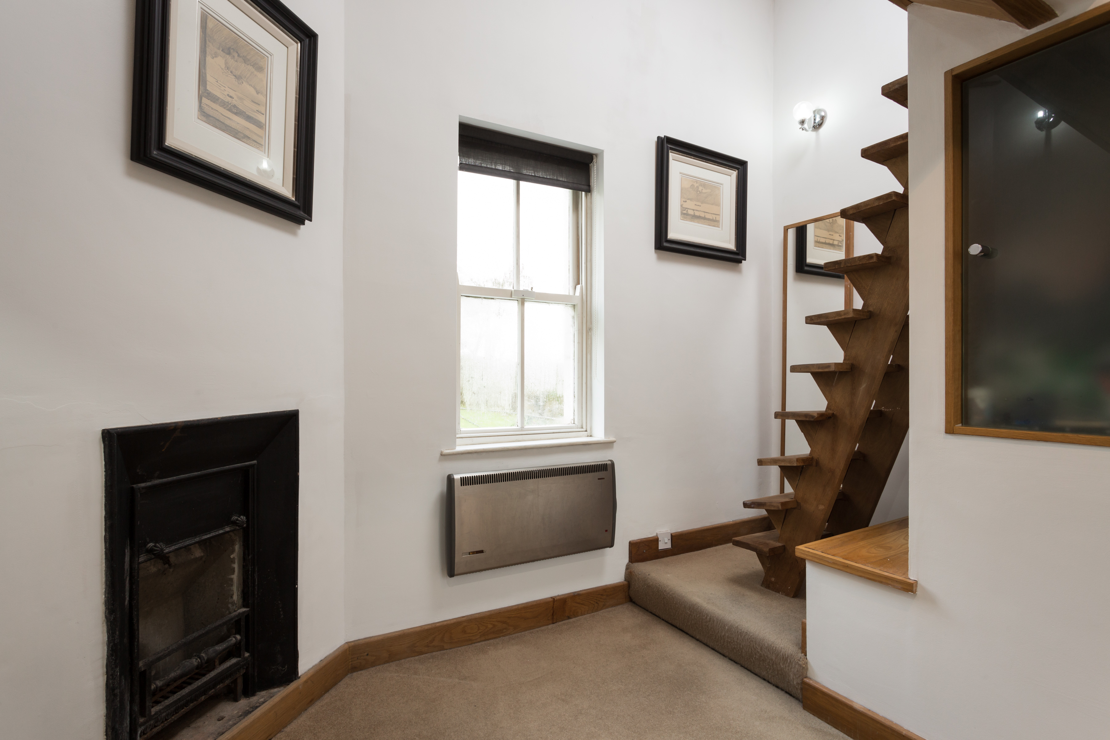 Stairs lead to a mezzanine level where there is a double bed