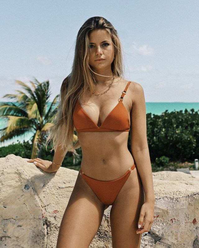 Model Ines Tomaz shows off her stunning curves in an orange bikini