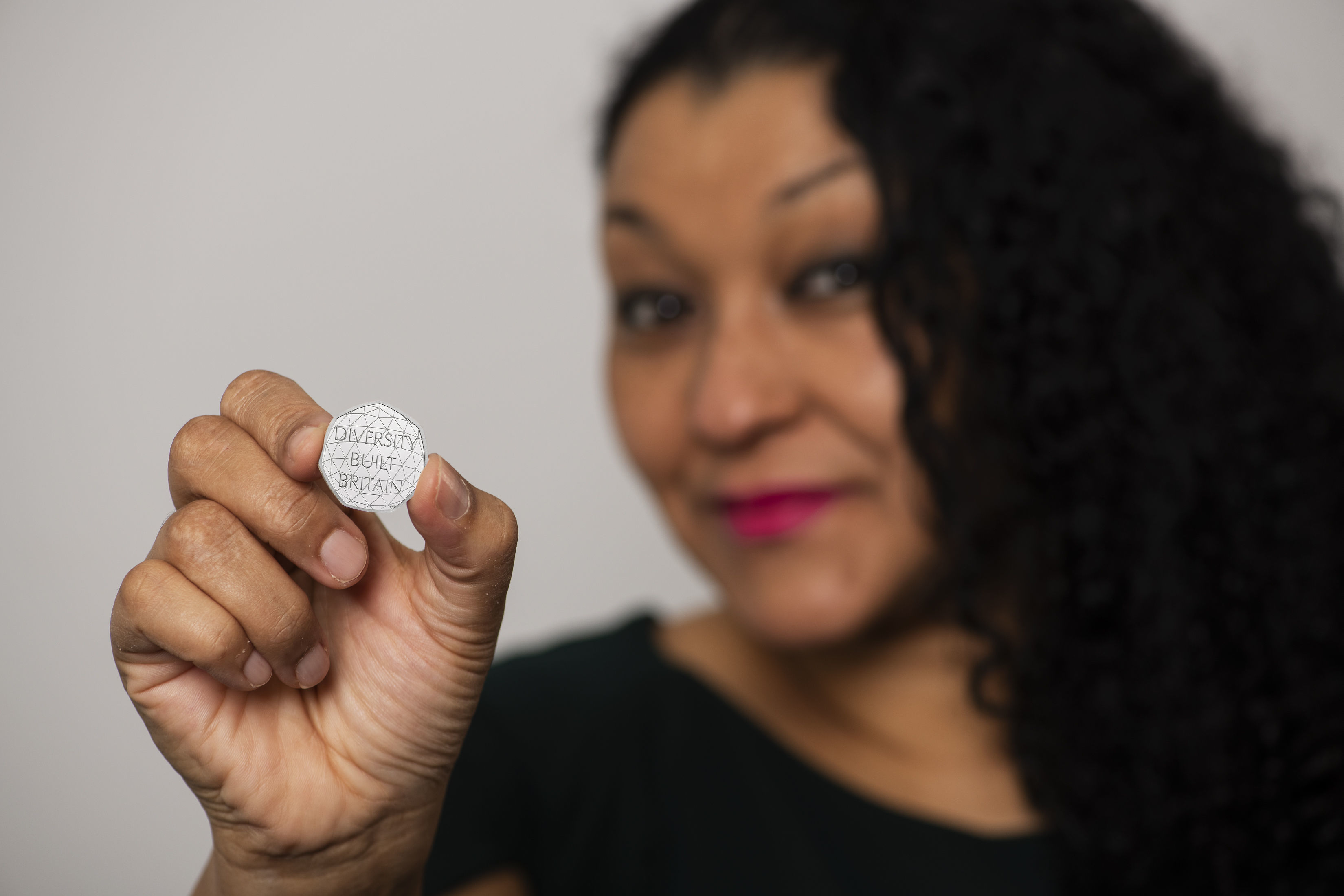 Coin designer Dominique Evans with the new 50p piece
