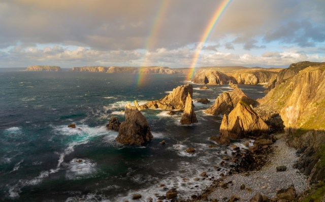 A spectacular double rainbow shot at Mangersta sea stacks, Isle of Lewis, Scotland by Richard Fox