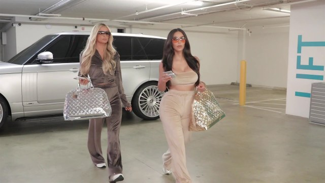 Kim and Paris were seen in velour trackies and crop tops