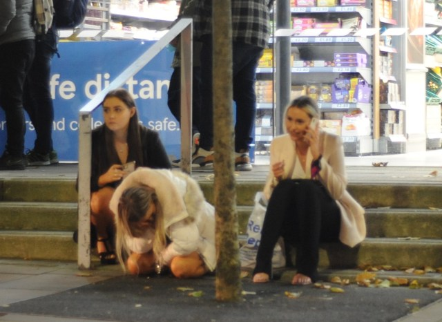 It all got too much for one girl, who was seen resting her face on her hand as she waited outside Tesco