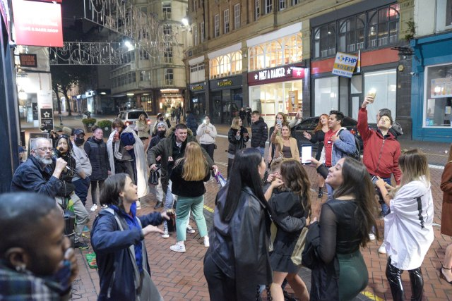 People who may have been drinking within household groups gathered to dance in the street after 10pm