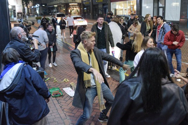 In Birmingham, buskers set up huge PA systems to draw the crowds