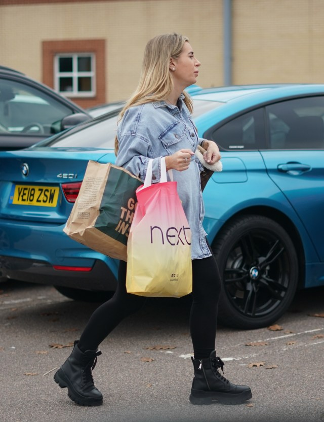 The 23-year-old star looked comfy in chunky black boots, leggings and a denim shirt