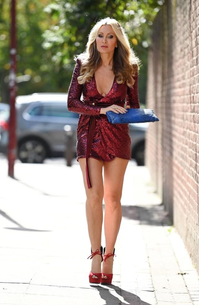 Caprice looks festive in this crimson dress